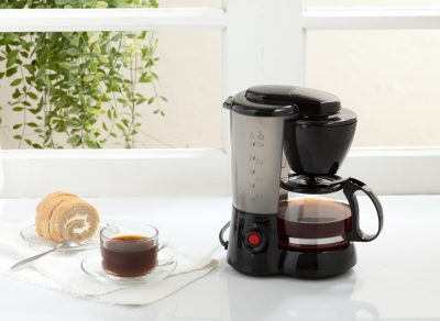 autodrip coffee maker next to a coffee
