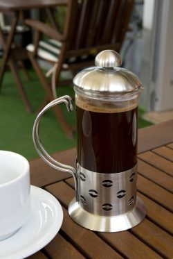 french press brewing on table