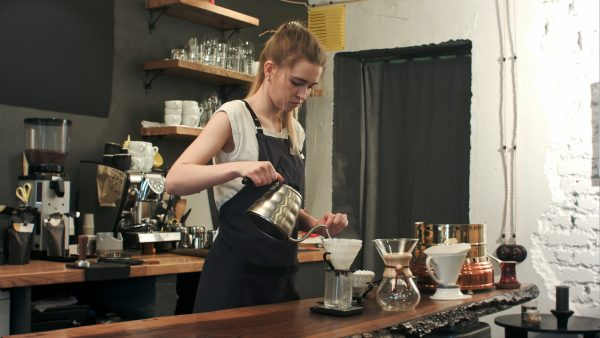 a barista making some pour over