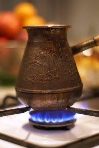 a flame underneath a cezve