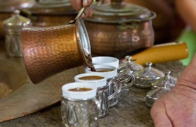a row of cups of Turkish coffee
