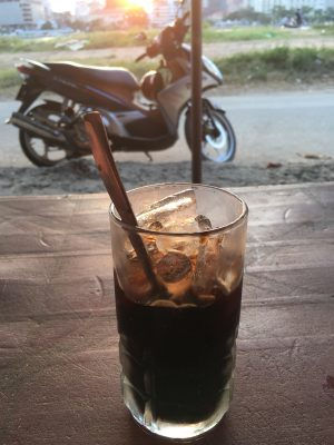 an iced Vietnamese coffee by the side of the road