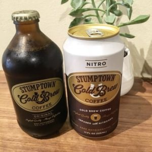 a bottle of nitro coffee and a can of cold brew