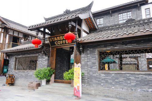 a starbucks in china with traditional red lanterns