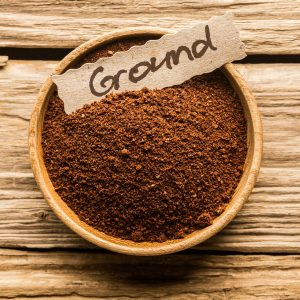 ground coffee with a sign saying grind