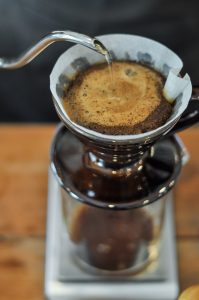 the coffee bloom in a pour over device