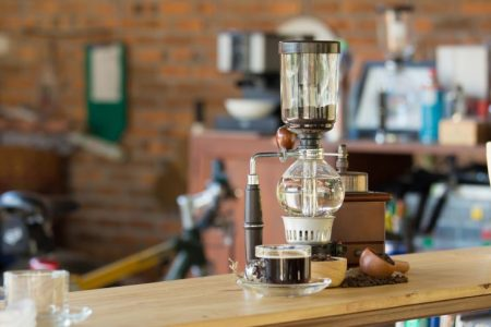 siphon coffee maker sitting on a worktop